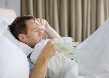 Man-sick-in-bed-drinking-hot-drinknnn.jpg